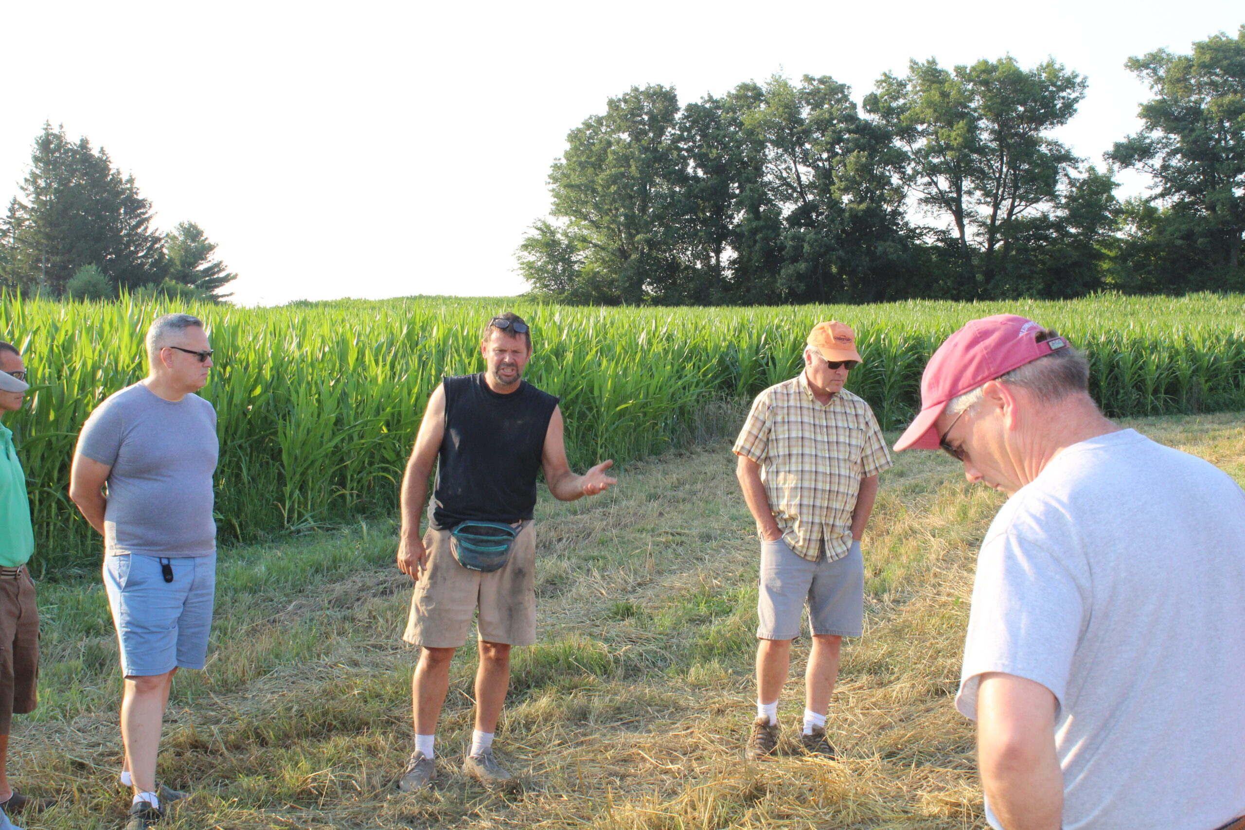 Dairy and grain farmer Greg Friendshuh talks with participants at a Western Wisconsin Conservation Council field day in July at his farm in Clear Lake.